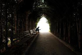 Person at end of tunnel